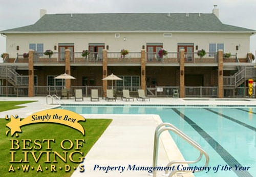 back of house with pool and property management award